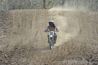 Motocross Racer Riding Down A Dirt Hill Editorial Stock Photo   Image