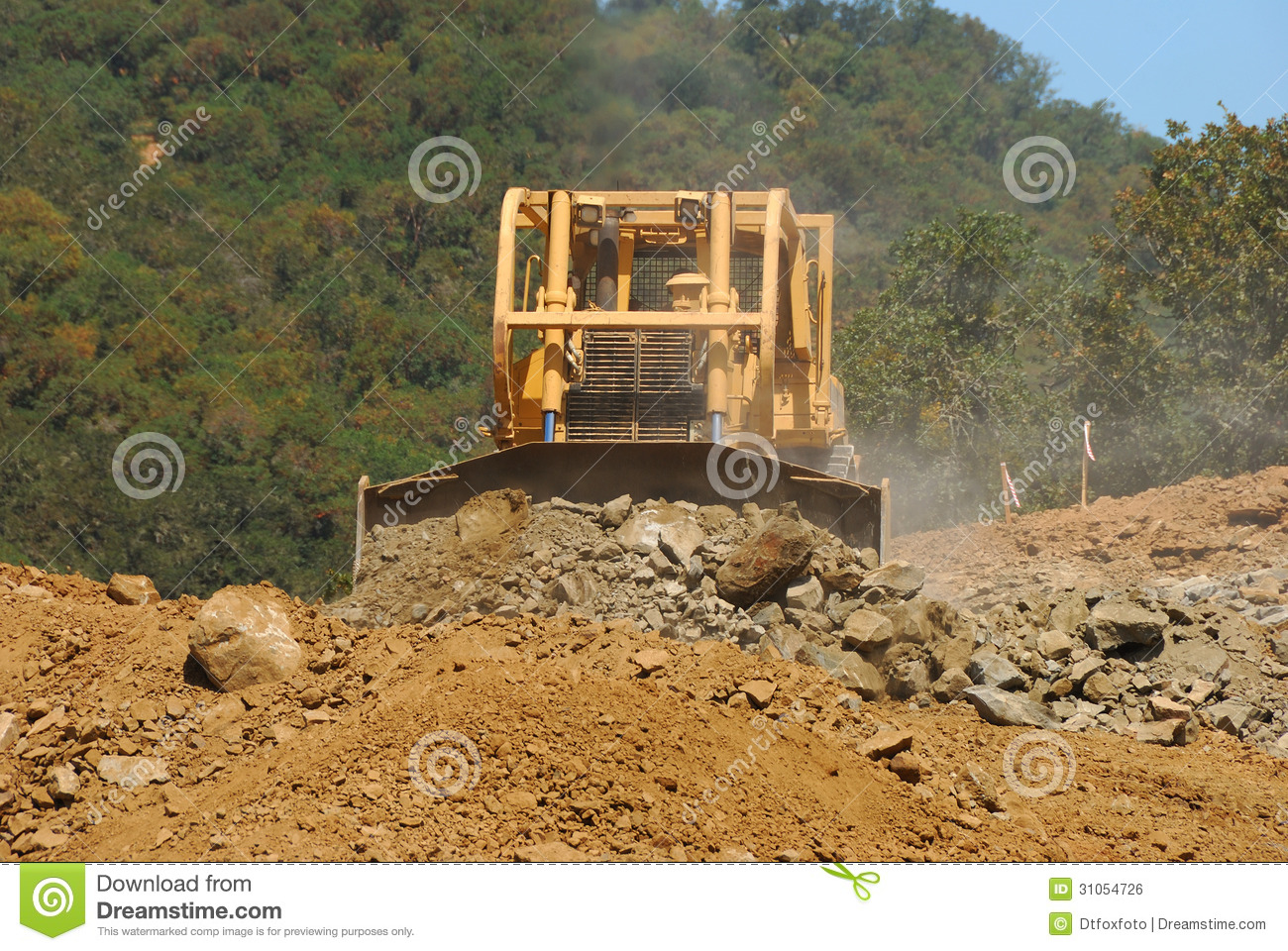 Moving Rock And Dirt From A Hill For A New Commercial Development