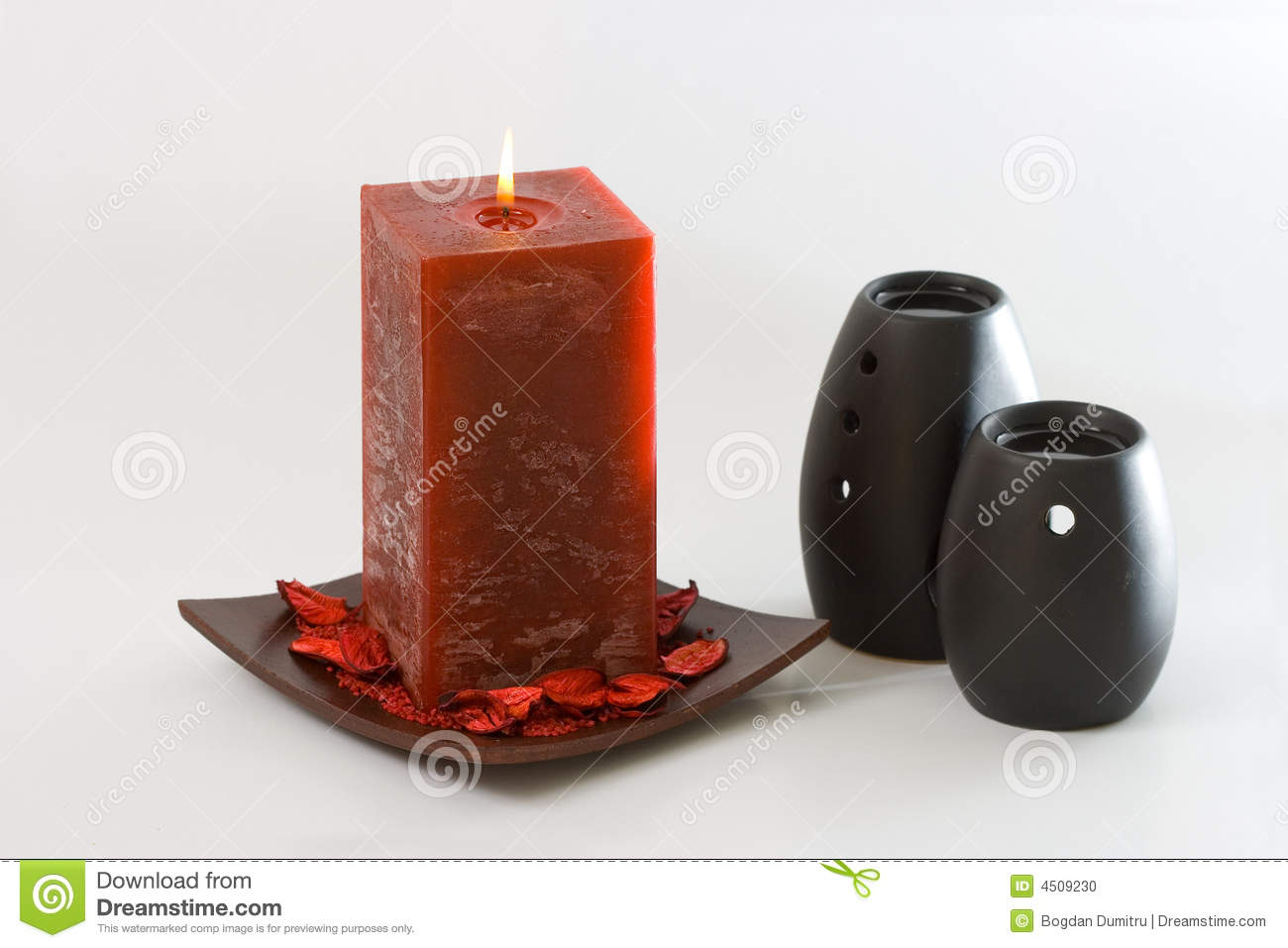 Red Scented Candle And Black Ceramic Aromatic Oil Burners Isolated On