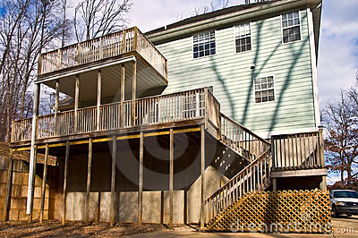 Back Side Of A House Showing The Rear Deck Porch Areas With Steps To