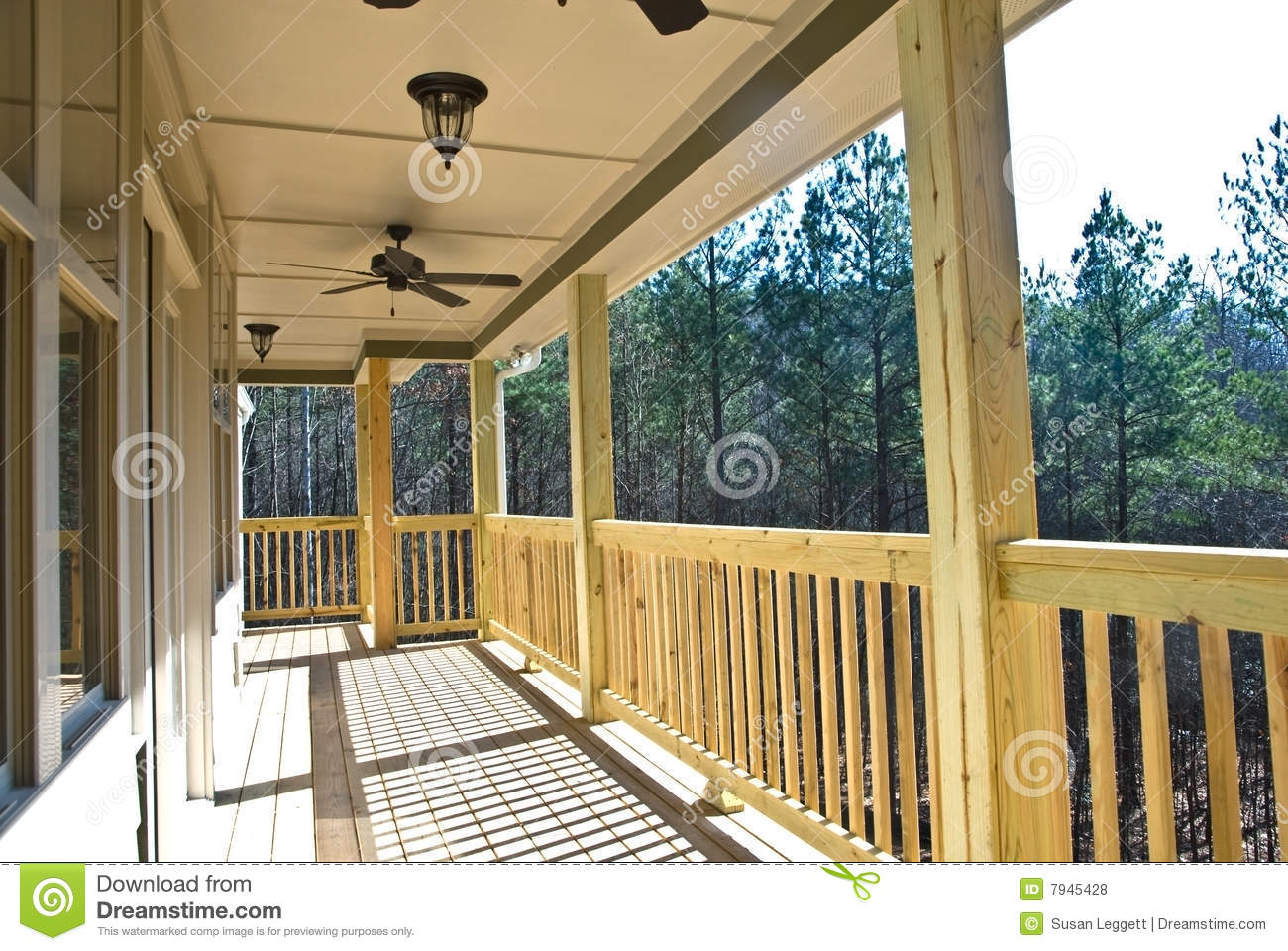 Wood Deck Running Along The Back Of A House Finished Ceiling With