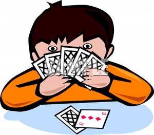 Cartoon Of A Boy Playing Cards   Royalty Free Clipart Picture