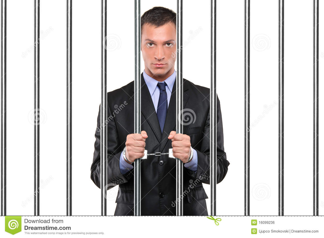 Handcuffed Businessman In Jail Holding Bars Royalty Free Stock Image