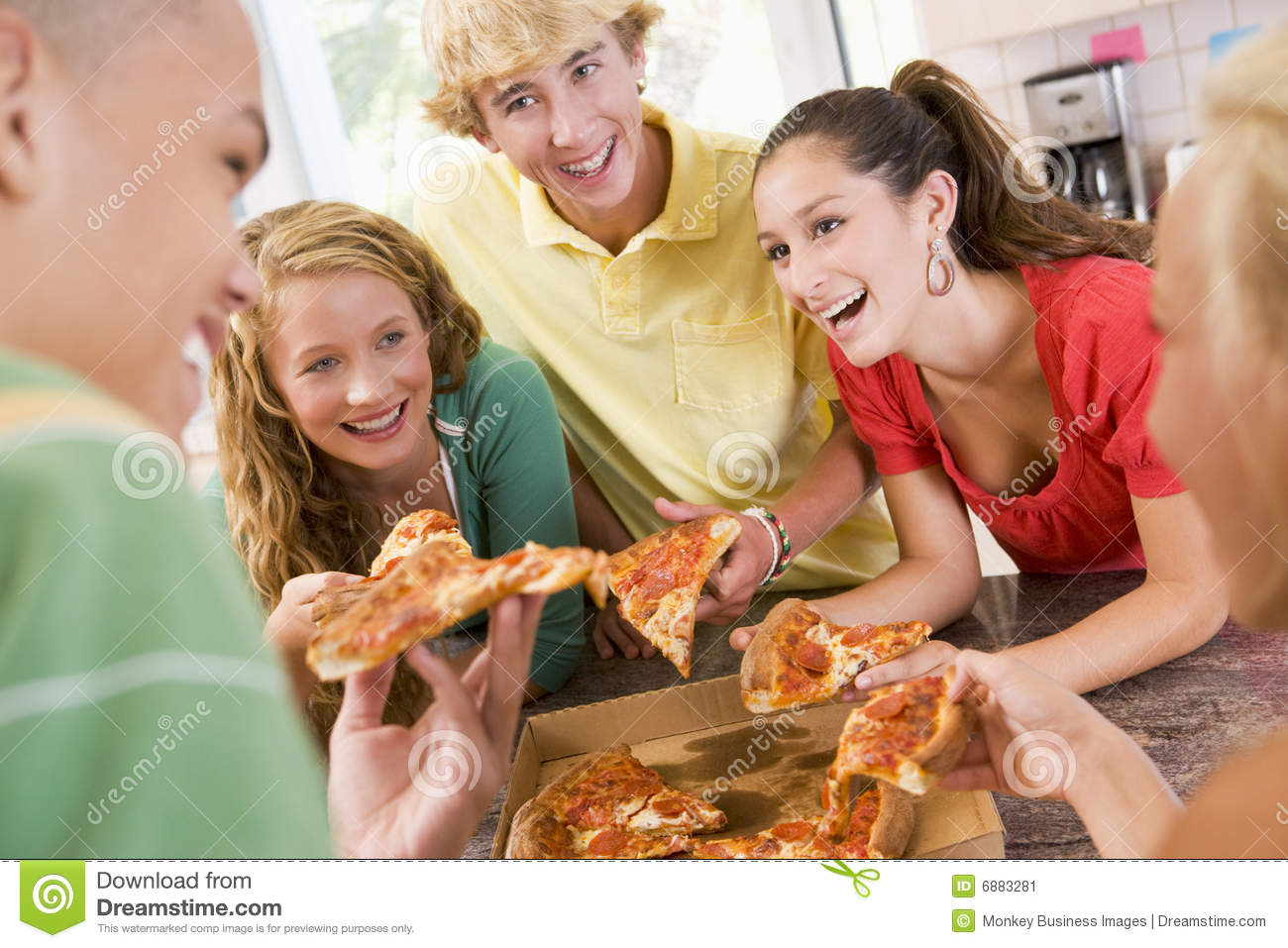 Group Of Teenagers Eating Pizza Stock Image   Image  6883281
