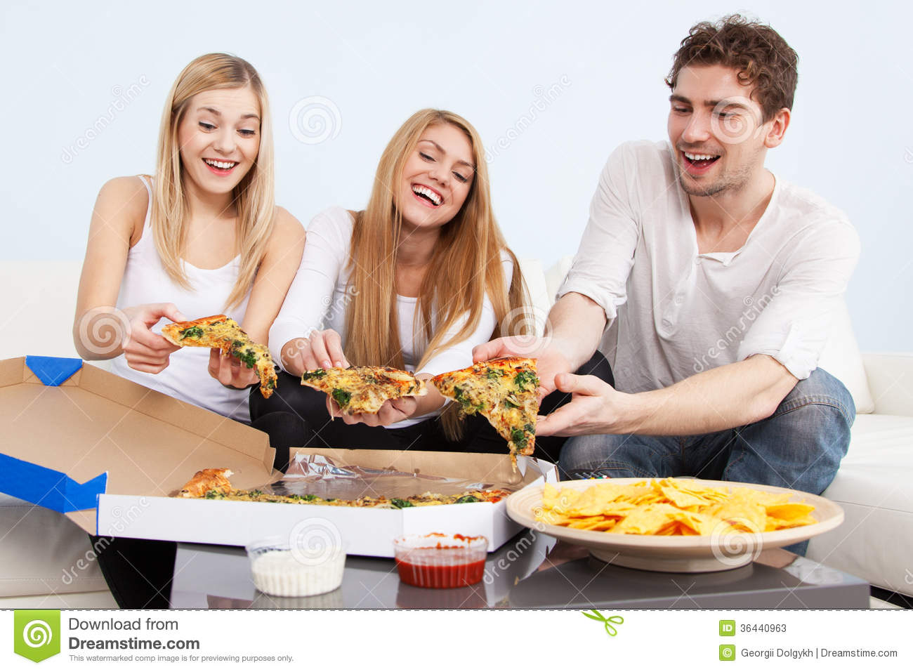 Group Of Young People Eating Pizza At Home Stock Photos   Image
