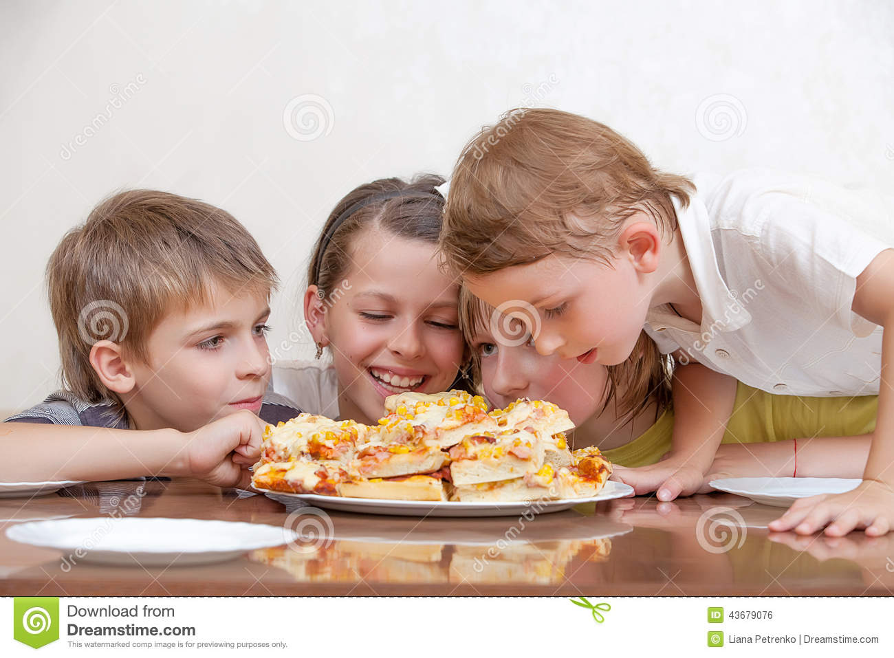 Stock Photo  Group Of Kids Eating Pizza And Smiling