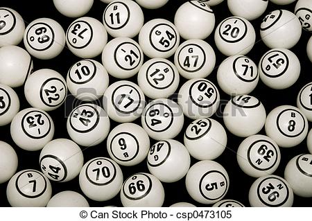 Black And White Bingo Balls With Numbers On A Black Background