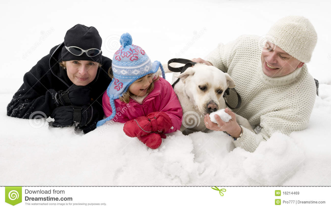 Family With Dog Playing In Snow Royalty Free Stock Images   Image