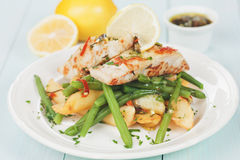 Fish Steak With Fried Potato And Green Bean Royalty Free Stock Photo