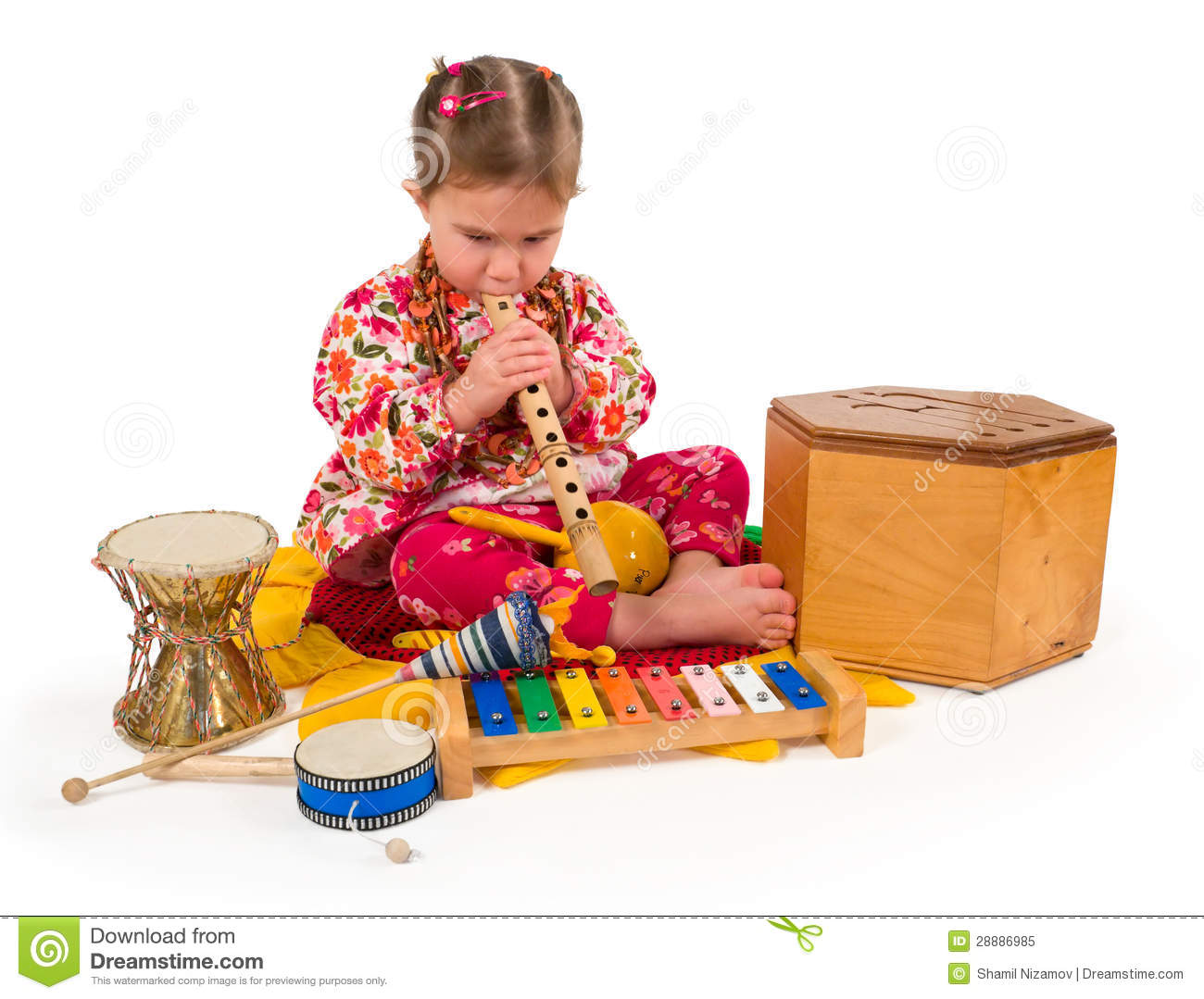 One Small Little Girl Playing On Drum Flute Maraca Xylophone