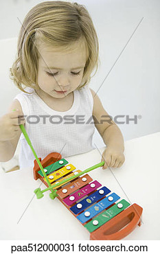 Stock Photography Of Toddler Girl Playing Xylophone High Angle View