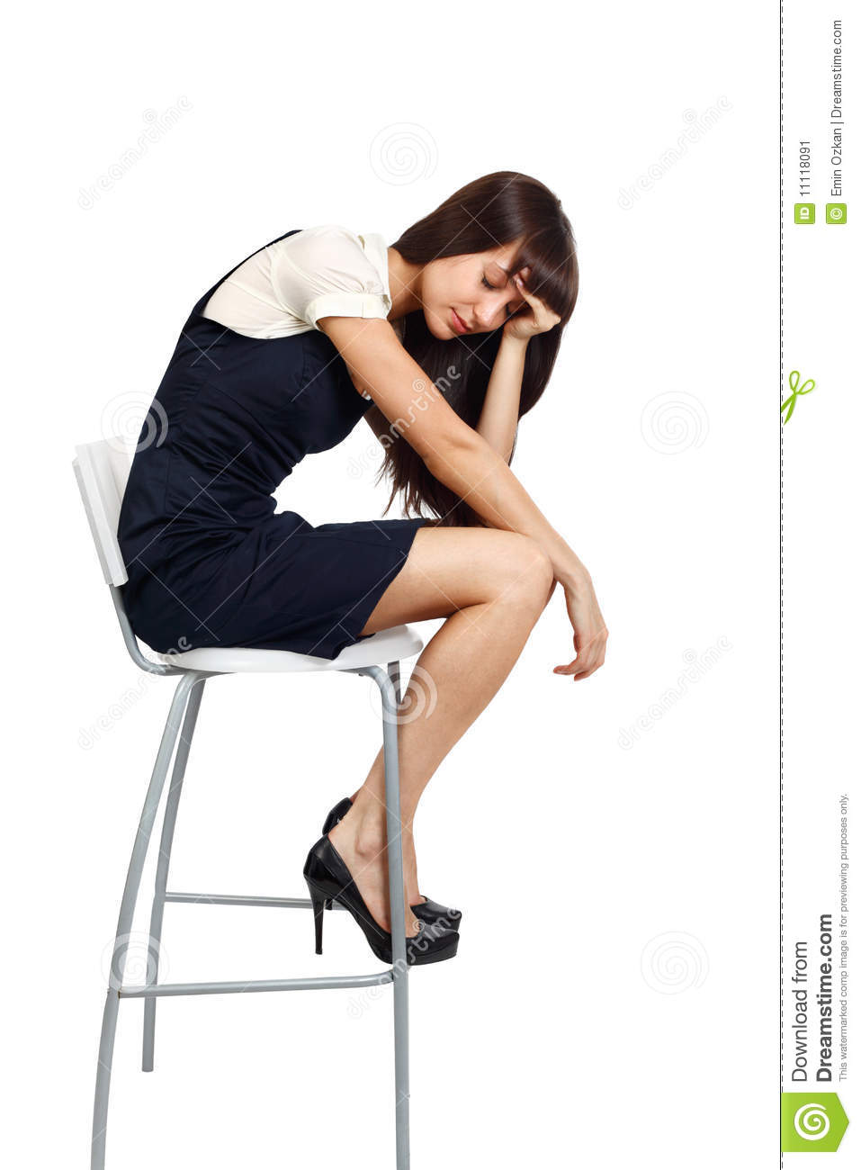 Young Businesswoman Sitting On A Tall Chair Looking Exhausted