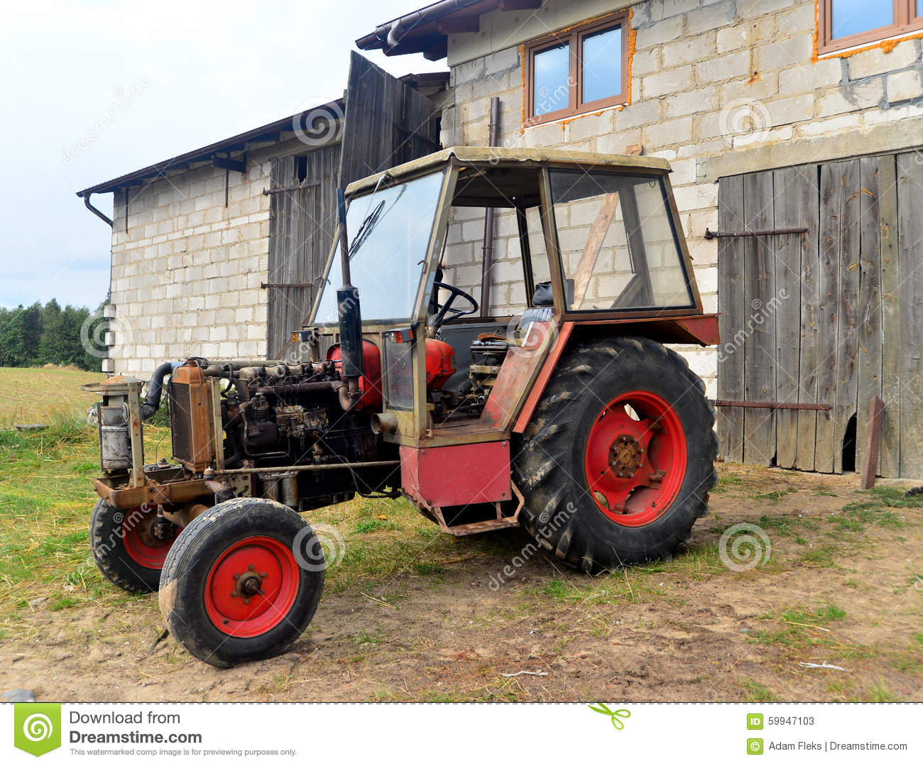 Ancient Tractor Without Engine Hood And Open Cooler On A Farm With
