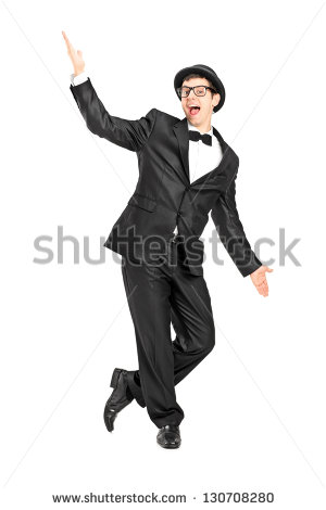 Full Length Portrait Of A Man In A Bow Tie Suit Dancing Isolated On