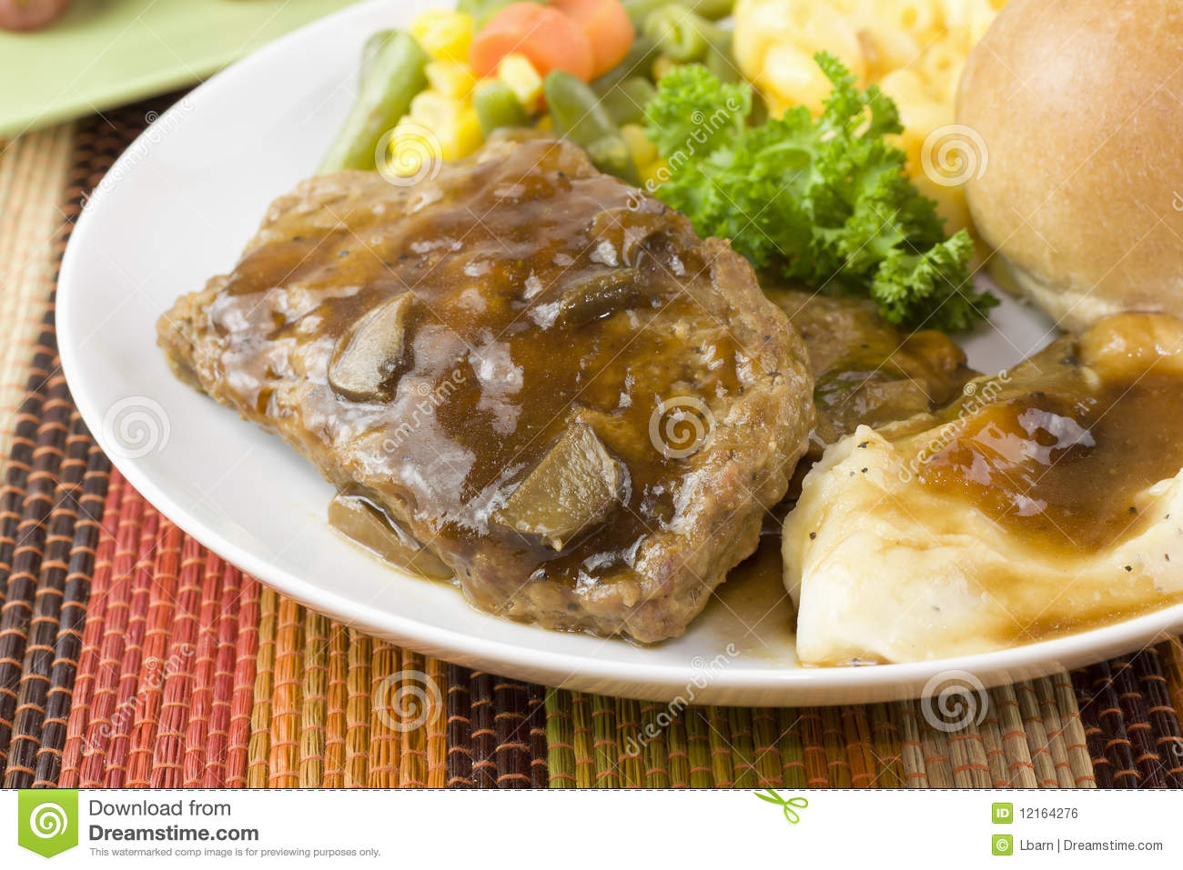 Closeup Of Meatloaf Slices With Mushroom Gravy Mashed Potato And