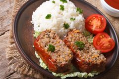 Meat Loaf With Rice On A Plate On A Table Royalty Free Stock Photo