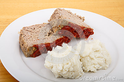 Serving Of Meatloaf And Mashed Potatoes On A White Plate