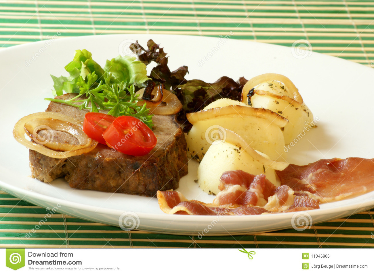 Sliced Meat Loaf With Bacon On A Plate Royalty Free Stock Image