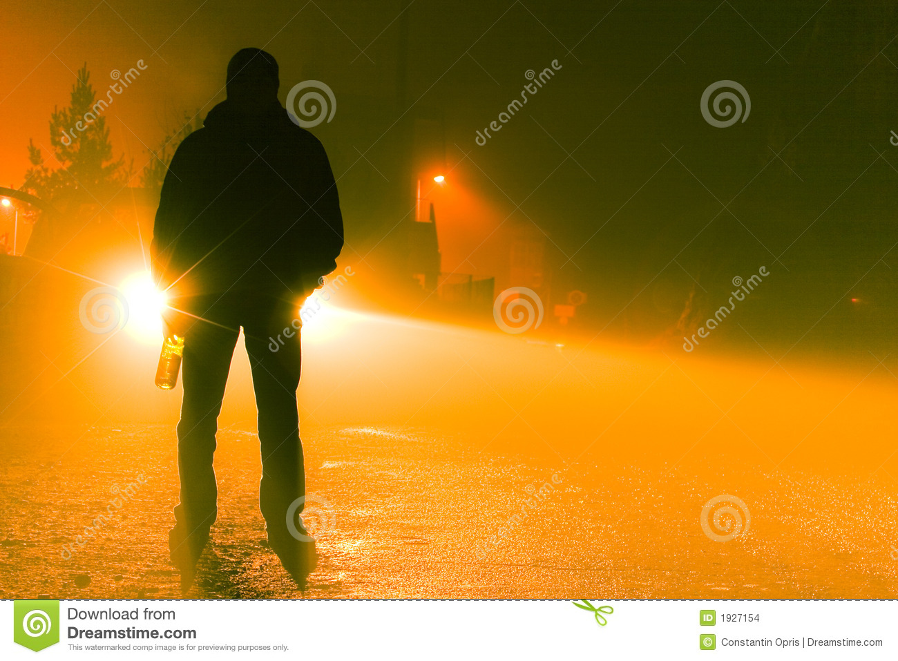 Silhouette Of A Drunk Person Standing On The Road On A Foggy Night