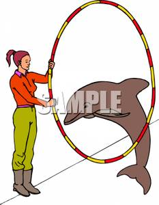 Clipart Image Of A Dolphin Jumping Through A Hoop Held By A Woman