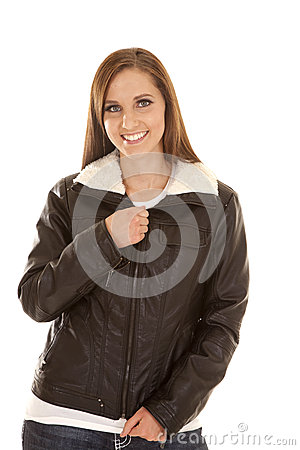 Woman With A Smile On Her Face Zipping Up Her Jacket