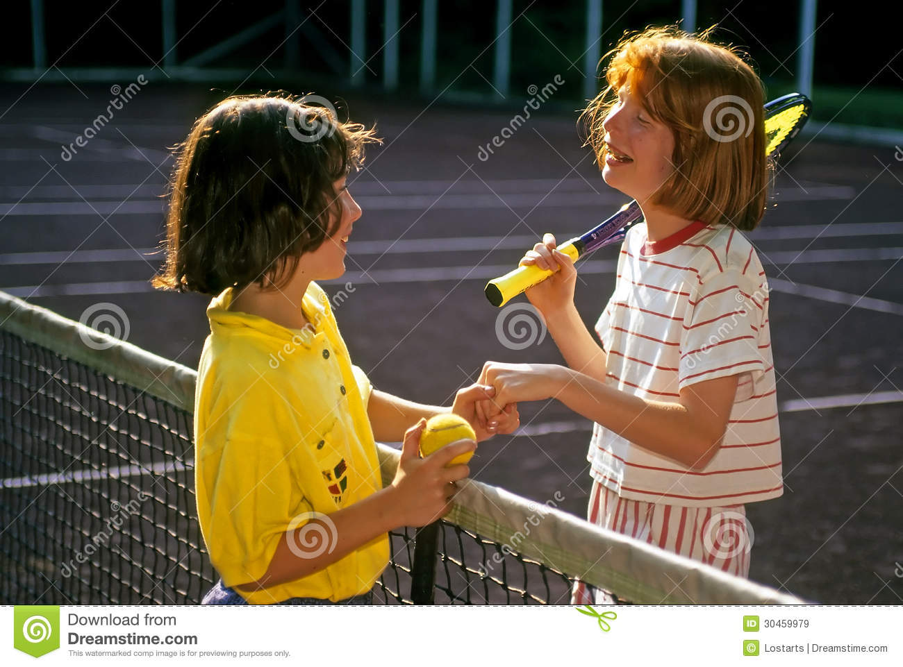 Two Girls At Summer Camp Demonstrate Good Sportsmanship After Their