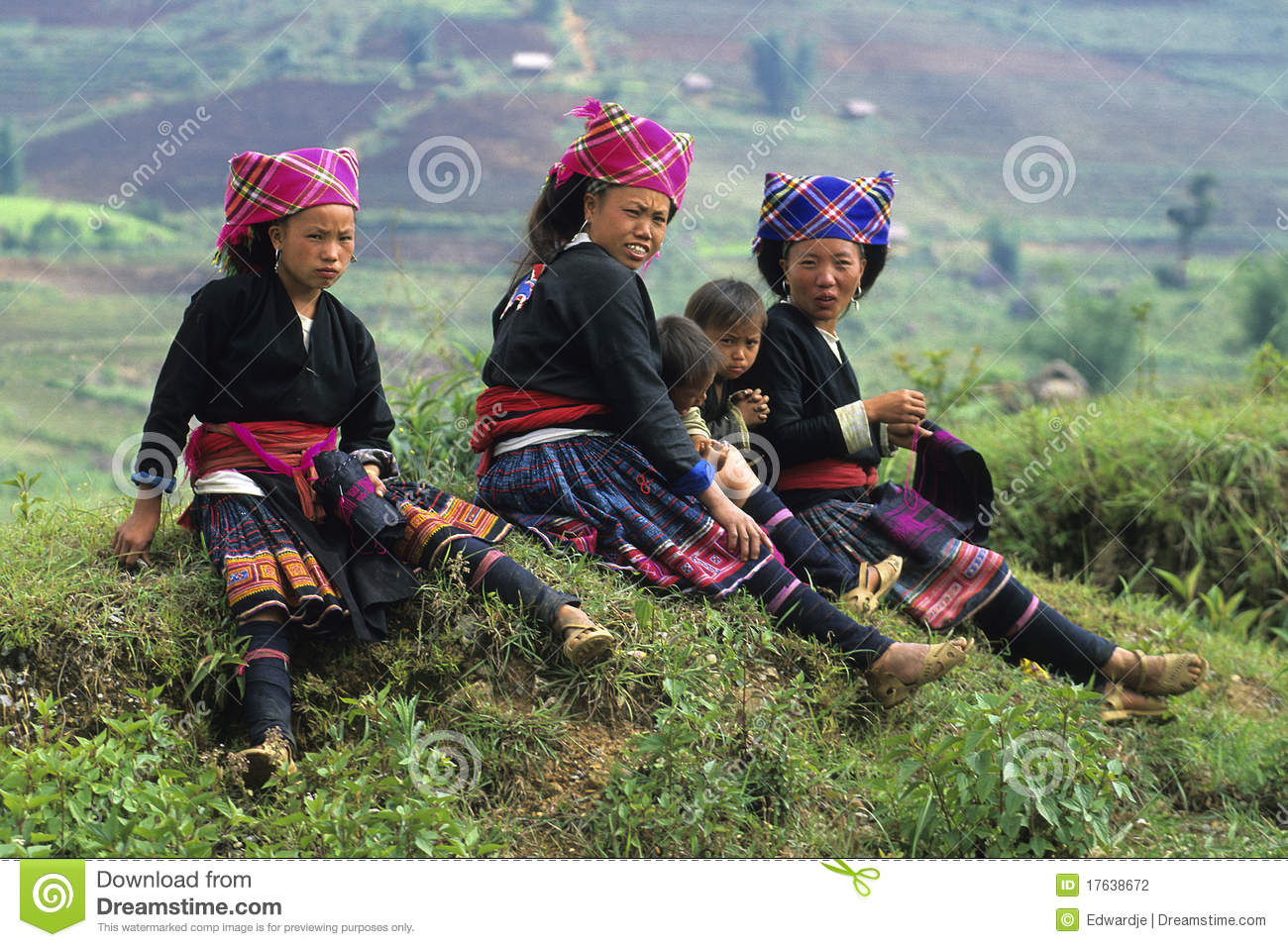 Flower Hmong Mothers And Children Siiting Along The Road Near Bac Ha