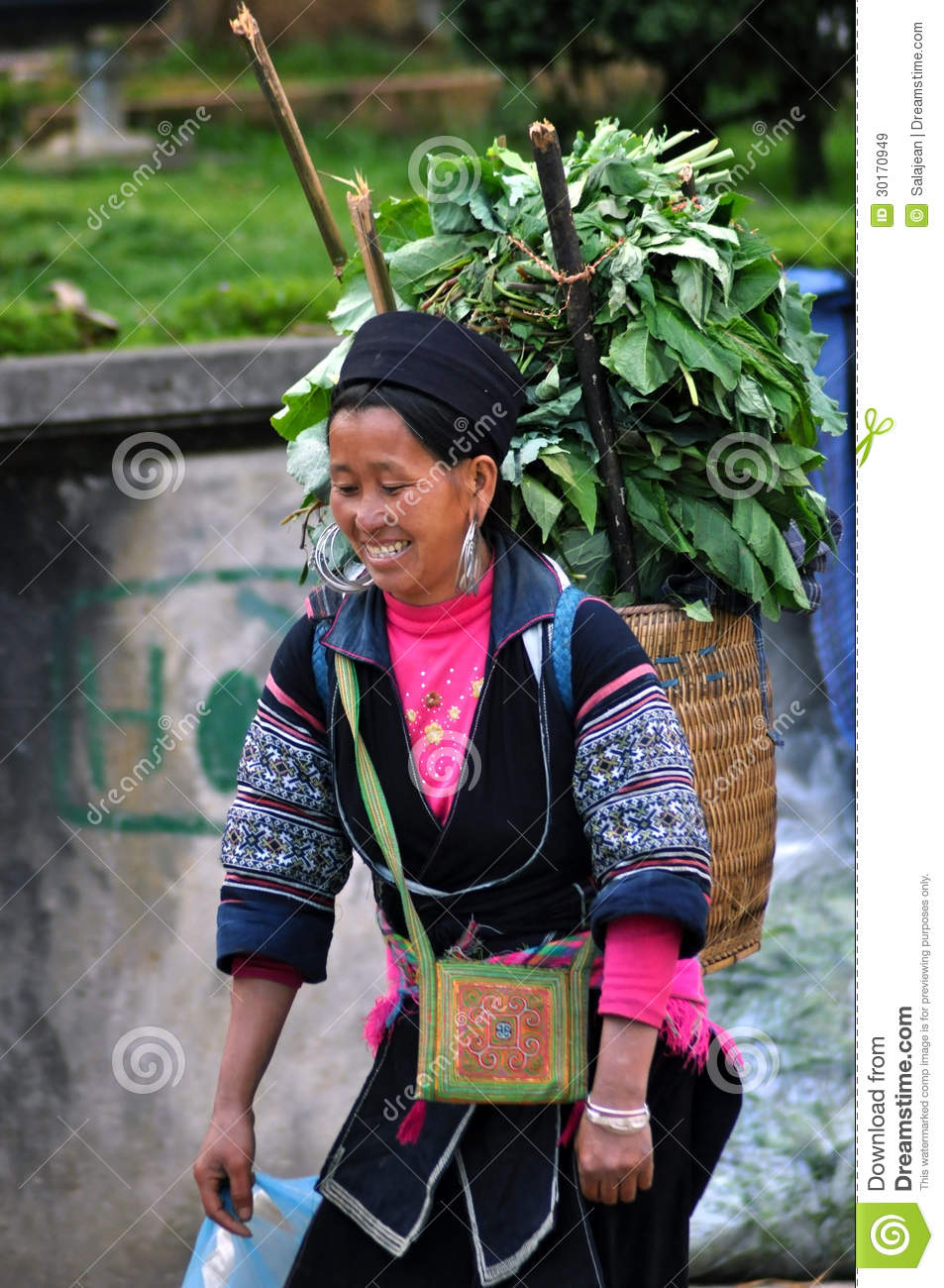 Hmong Tribe Woman Carrying Fresh Herbs On Her Back In Sapa  The Hmong