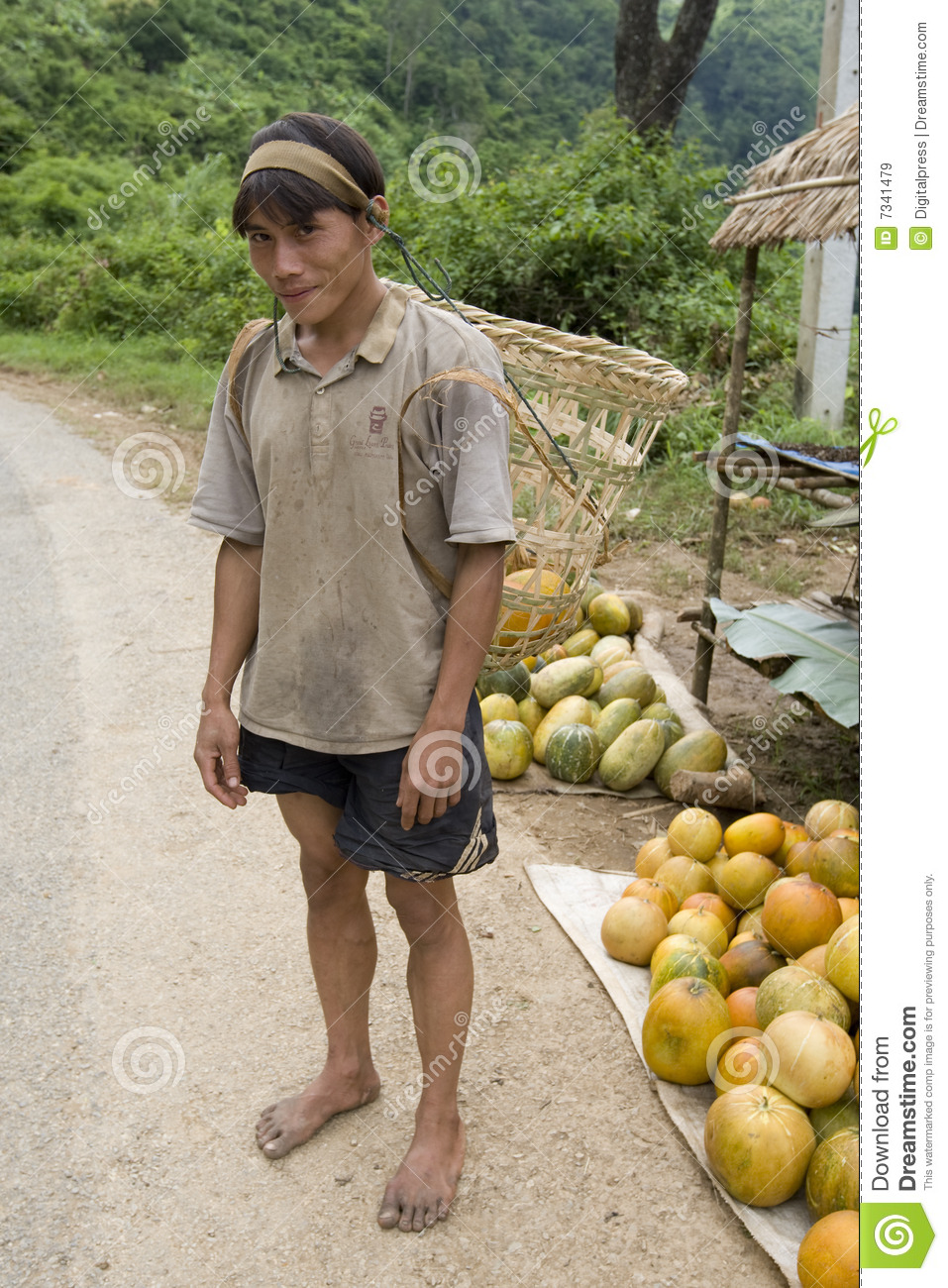 More Similar Stock Images Of   Hmong Man In Laos With Grape Container