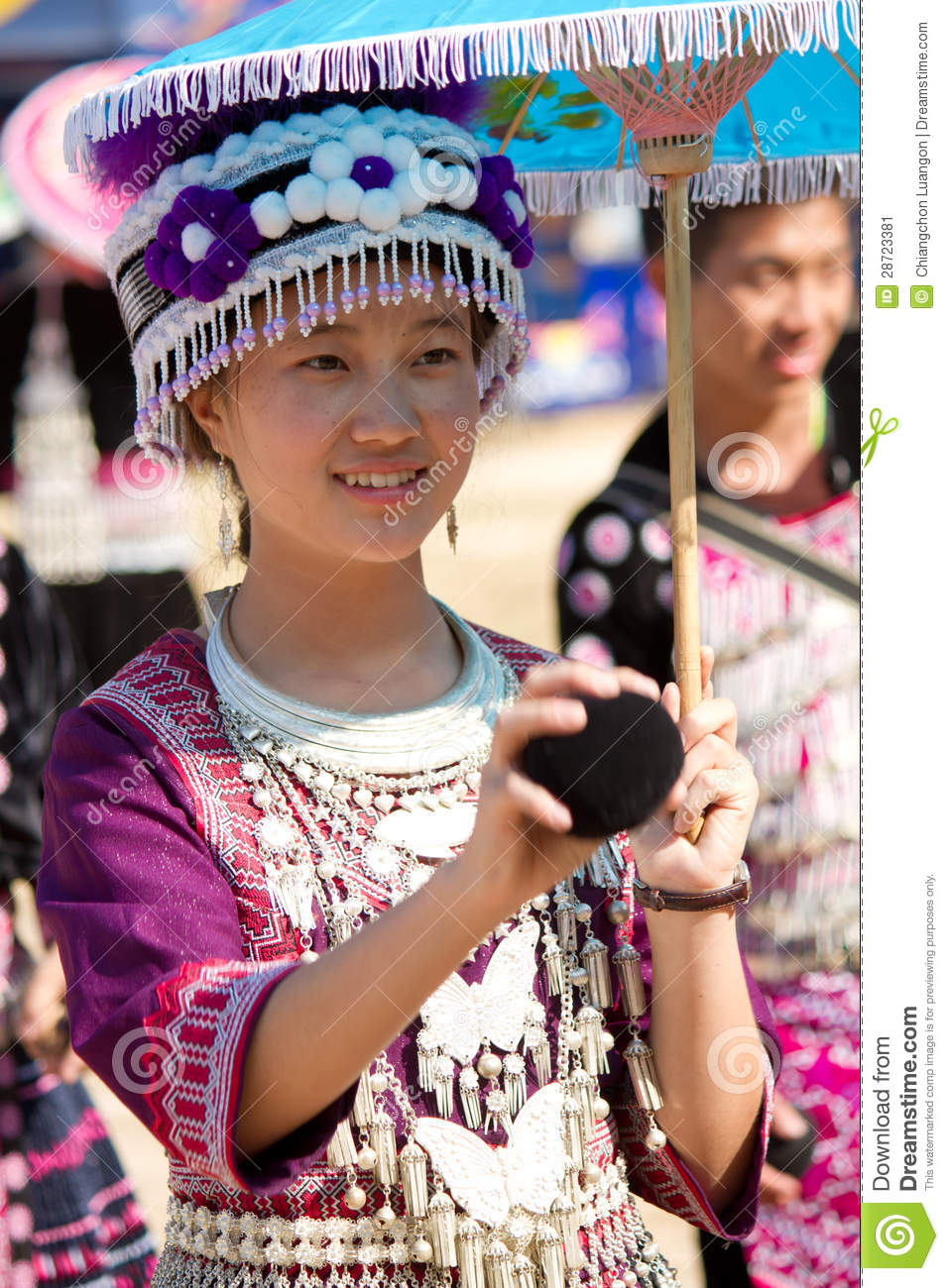 Traditionally Dressed Hmong Hill Tribe Woman Play A Ball In Hmong