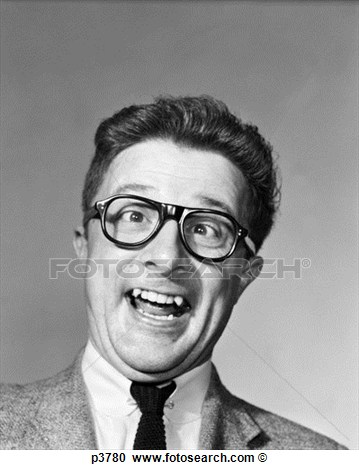 Man Wearing Black Plastic Frame Eye Glasses Making A Goofy Expression