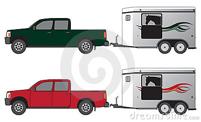 Pickup Pulling Horse Trailer With Horse Silhouetted In Trailer Window