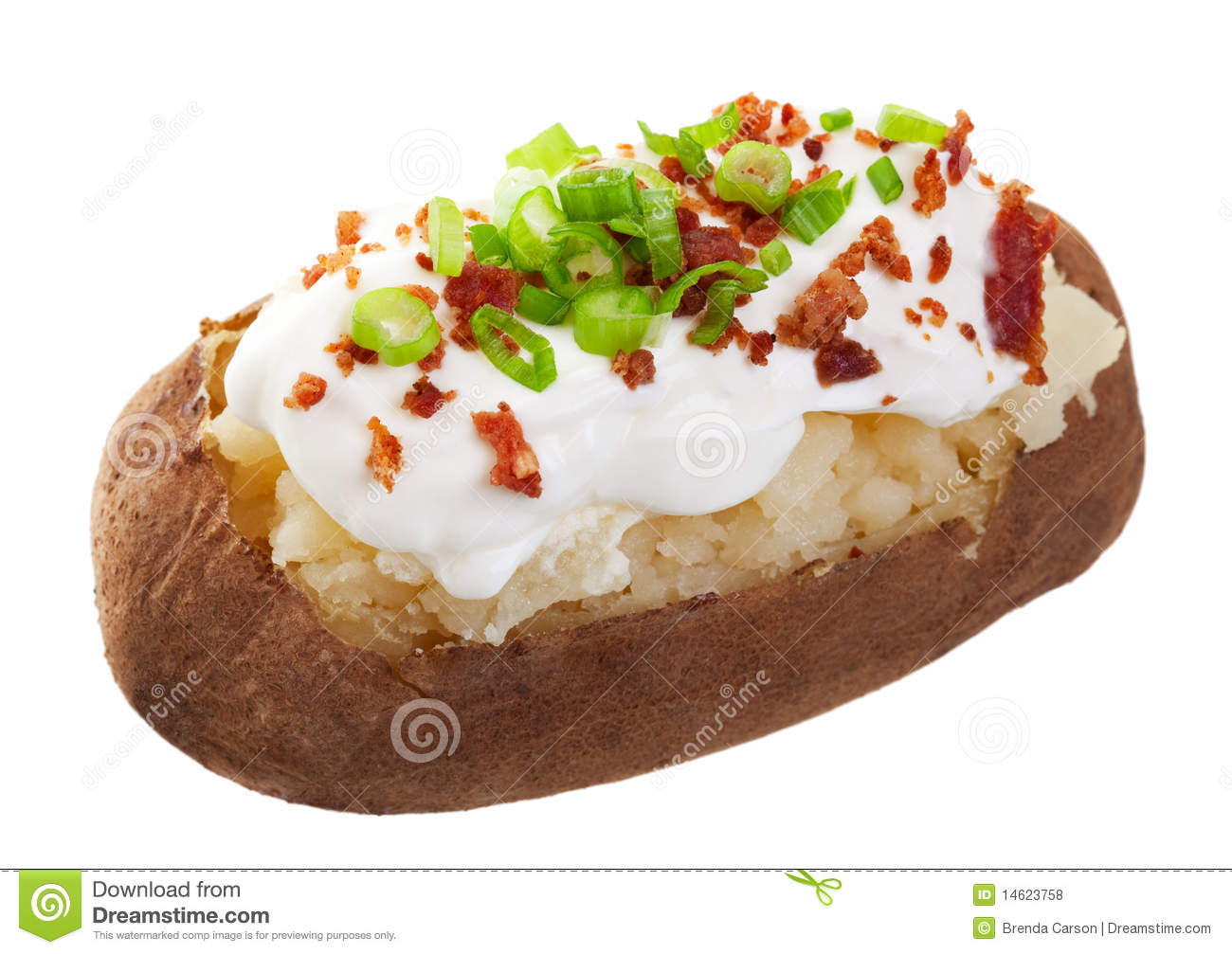 Baked Potato Loaded With Sour Cream Bacon Bits And Chives  Shot On