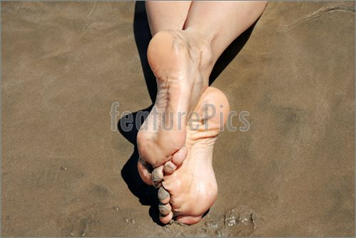 Image Of Crossed Feet In Sand  Stock Picture To Download At