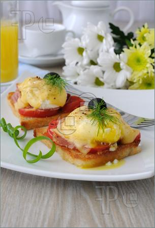 Eggs Benedict With Ham And Tomato On Toast With Cheese Picture  Image