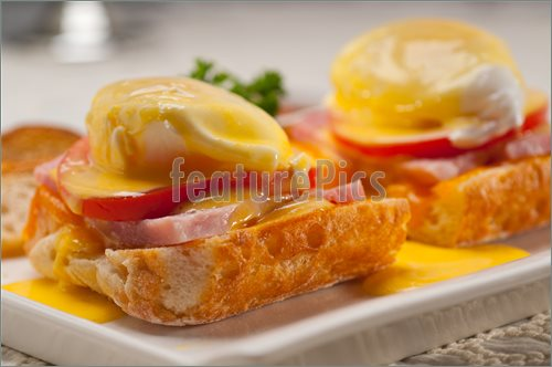 Image Of Eggs Benedict On Bread With Tomato And Ham  High Resolution