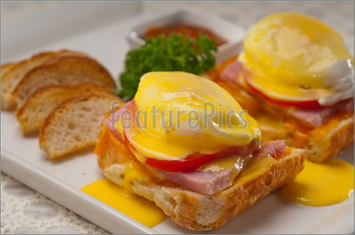 Picture Of Eggs Benedict On Bread With Tomato And Ham  Royalty Free