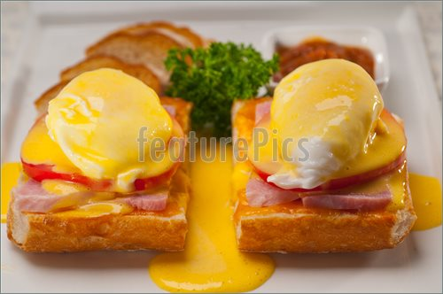Picture Of Eggs Benedict On Bread With Tomato And Ham  Stock Picture