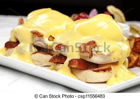 Pictures Of Double Stacked Eggs Benedict With Bacon And Hollandaise