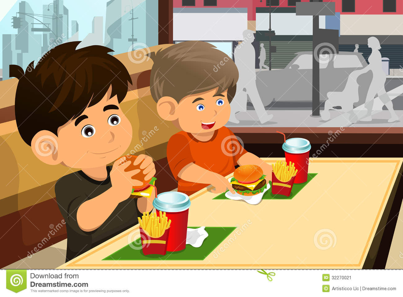 Of Happy Kids Eating A Hamburger And Fries In A Fast Food Restaurant