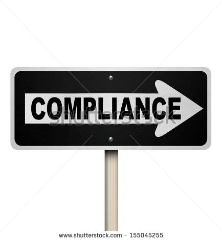 The Word Compliance On A Street Sign Pointing The Way To Complying