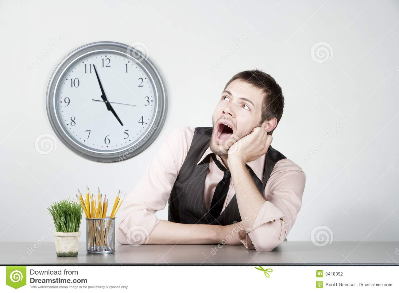 Young Man Bored At Work Stock Photography   Image  9418392
