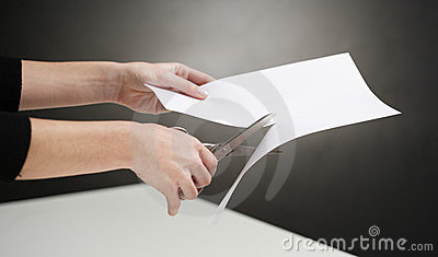 Hands Of Woman Cutting White Paper Over Table Black Background