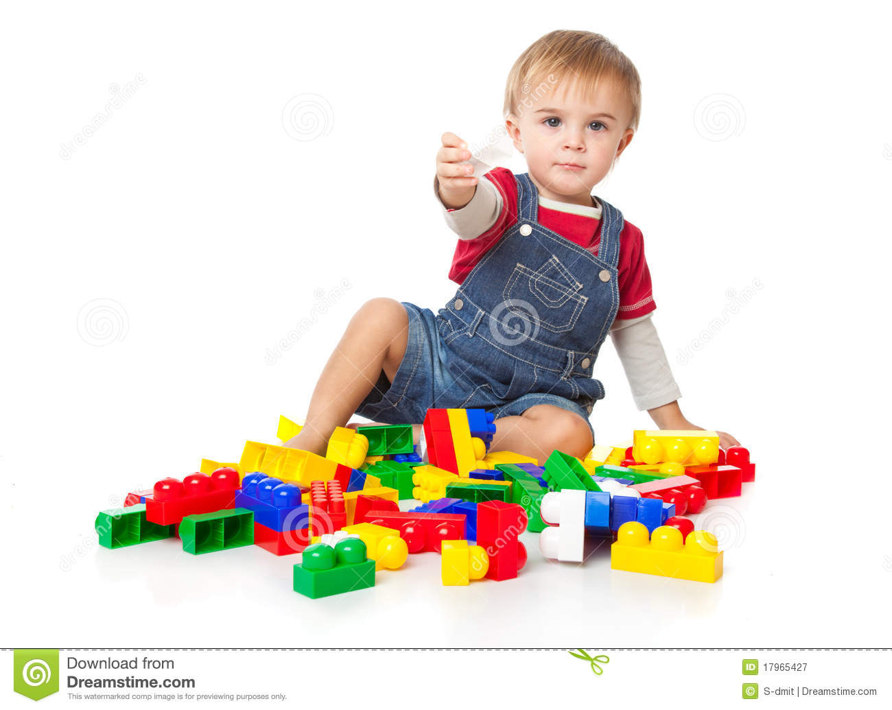 Child Playing With Legos A Funny Boy Is Playing With