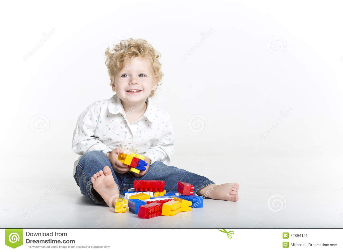 Cute Toddler Is Building With Legos Stock Image   Image  32894121
