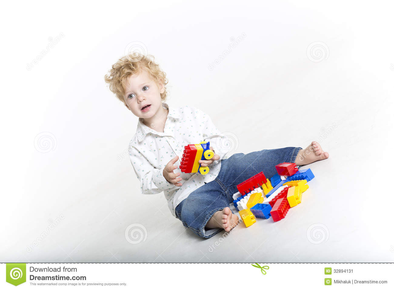 Cute Toddler Is Building With Legos Stock Image   Image  32894131