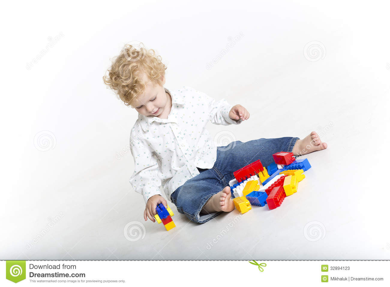 Cute Toddler Is Building With Legos Stock Photos   Image  32894123