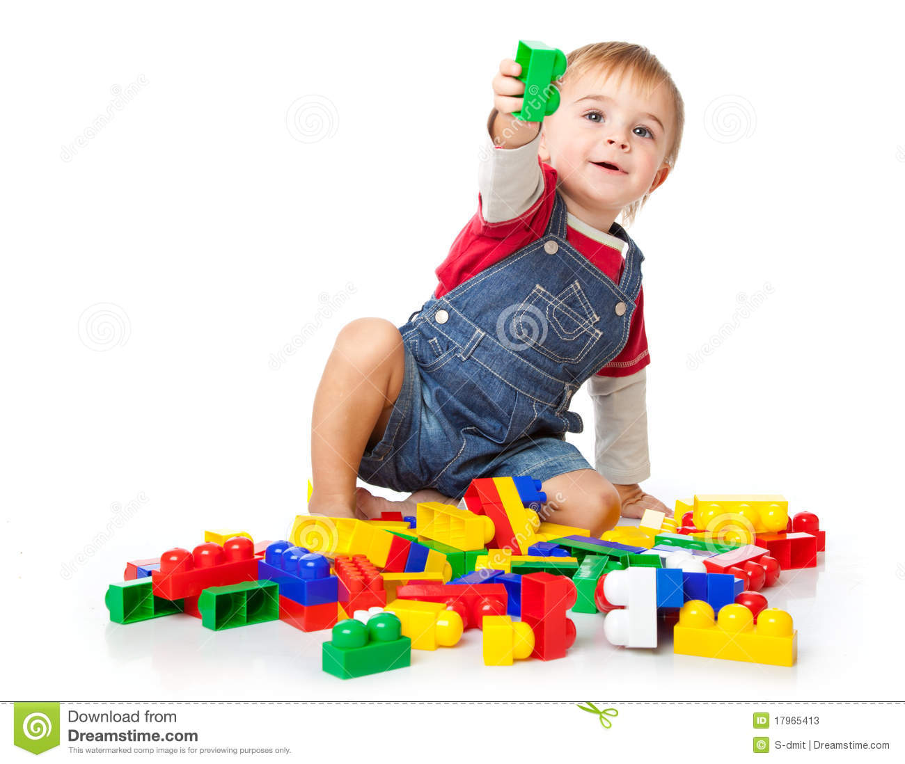 Funny Boy Is Playing With Lego  Isolated On A White Background