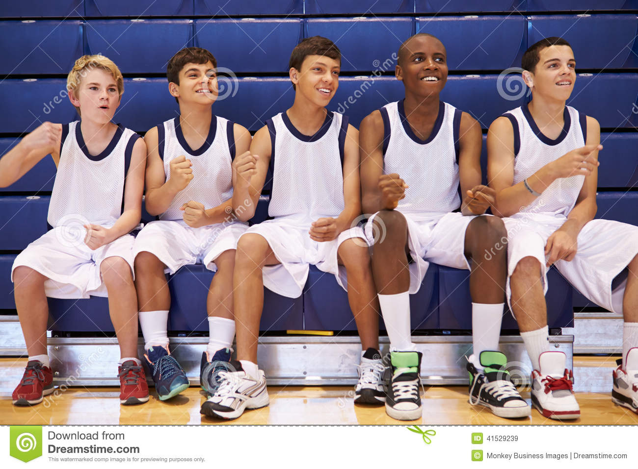 Members Of Male High School Basketball Team Watching Match Stock Photo