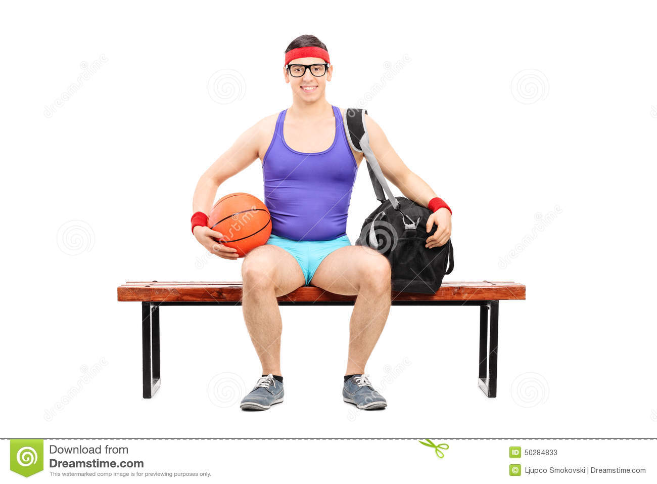 Nerdy Athlete Holding A Basketball Seated On A Bench Isolated On White